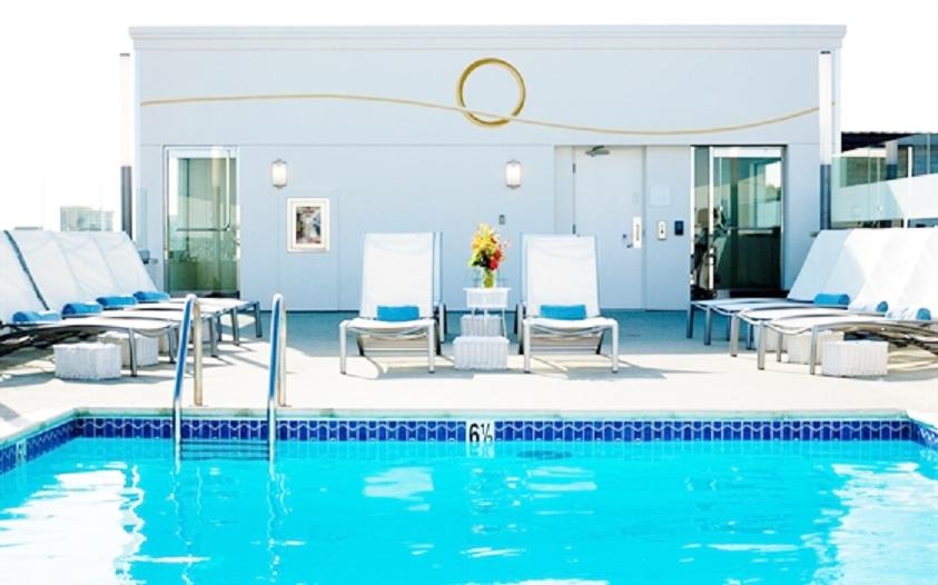 Carousel Hotel Pool Mural- Muralist Carolee Merril